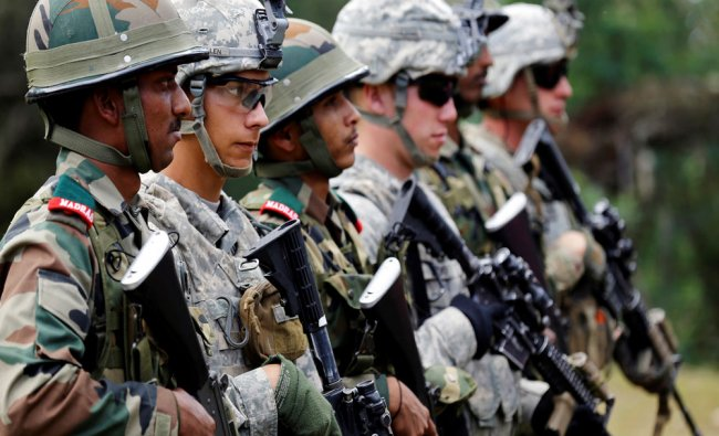 Indian and U.S. army soldiers take part in an Indo-US army joint combat exercise in Ranikhet...