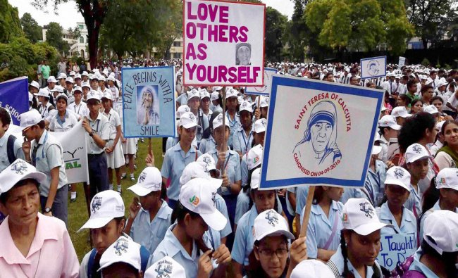 School students at \'Mother Walk\' rally to commemorate the canonization of Mother Teresa in Kolkata