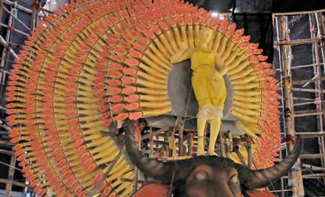 \'Thousands Hands\' Goddess Durga being prepared at a community puja pandal ahead of the Durga Puja...