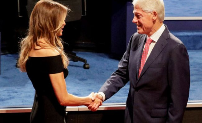 Bill Clinton shakes hands with Melania Trump, wife of Donald Trump before the presidential debate...