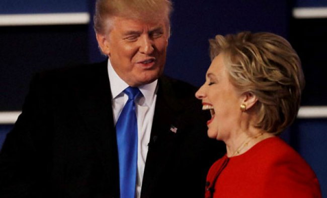 Donald Trump shakes hands with Hillary Clinton following the presidential debate...