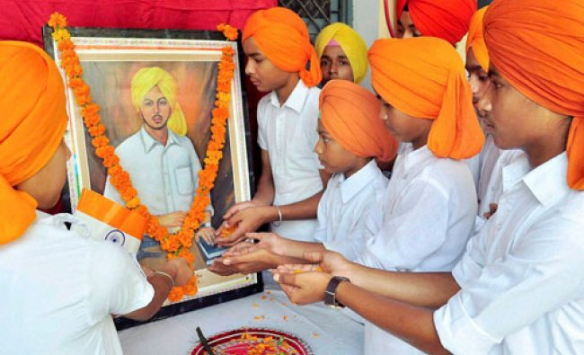School students pay tribute to Shaheed Bhagat Singh on his birth anniversary at a School...