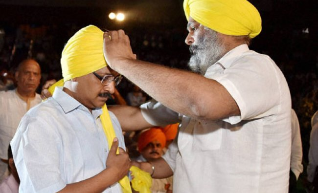 Kejriwal is tied a turban during a programme on 110th birth anniversary of Shaheed Bhagat Singh...