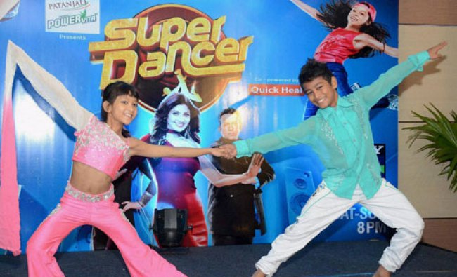 Finalists of a dance reality show Ashish Das and Masoom Narzary perform at a show...