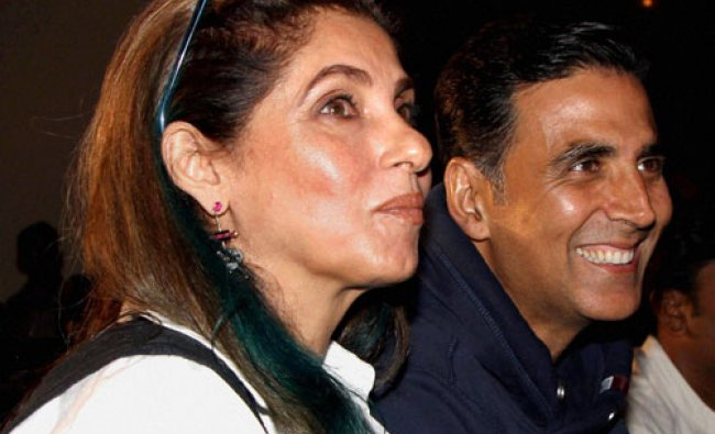 Akshay Kumar with his mother-in-law actress Dimple Kapadia attending the music launch...