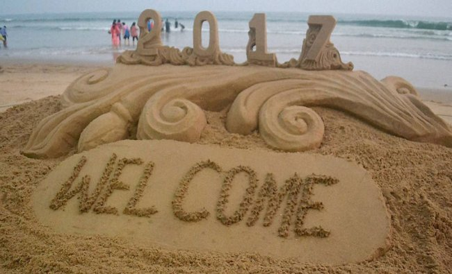 Sand artist Sudarsan Pattnaik has created a sand sculpture with message of New year 2017 greetings..