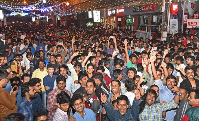 People celebrating and welcoming New Year at Brigade Road in Bengaluru...