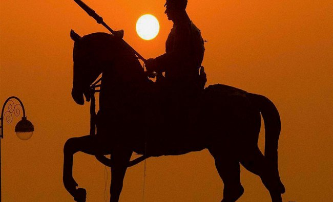 The Maharana Pratap Smarak is silhouetted against the first rising sun of Year 2017 in Ajmer...