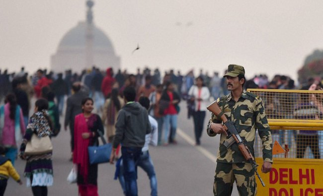 A security person guards as people visiting the Raisina Hill on the first day of New Year 2017...
