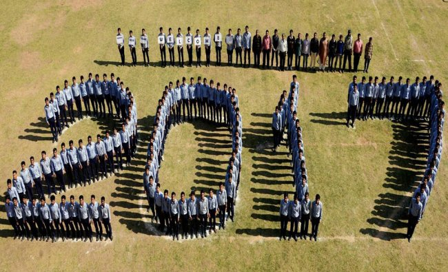 Students making a human chain that reads \'2017\' to welcome the New Year 2017 in Jodhpur...