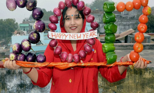 Woman artist Anita Mishra displays her vegetable artwork that reads \'2017\' on New Year 2017...