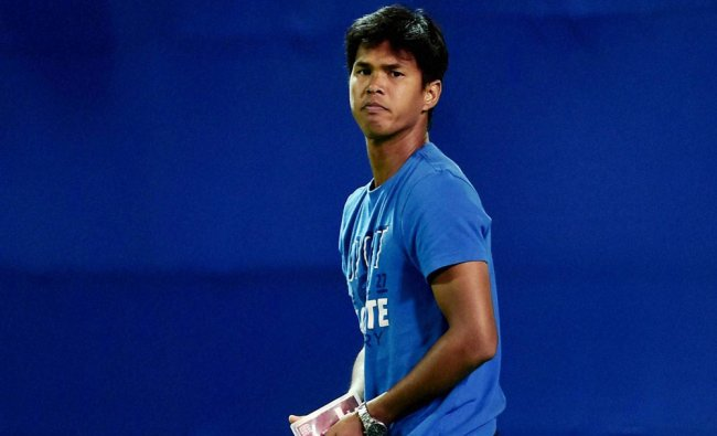 Indian tennis player Somdev Devvarman during a match between India\'s Prajnesh Gunneswaran...