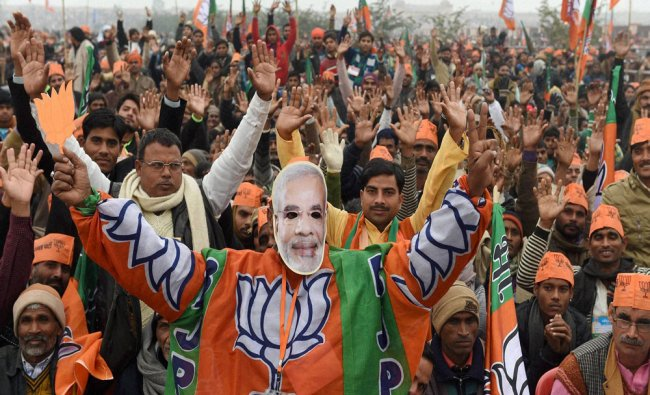 BJP supporters at the party\'s Parivartan Rally in Lucknow on Monday...