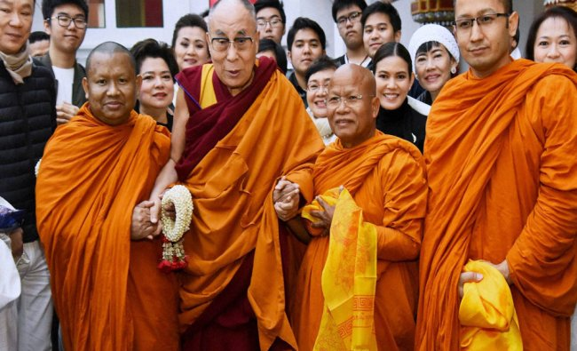Tibetan spiritual leader the Dalai Lama with high monks and devotees on the first day of...