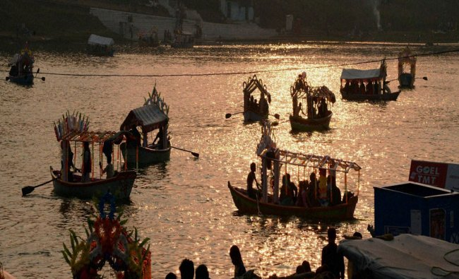 People enjoy boating on the Narmada river on the first day of new year 2017 in Jabalpur on...
