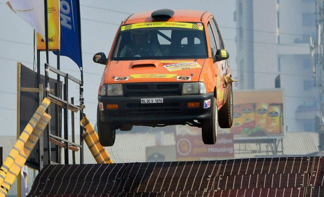 Enthusiast in the middle of a stunt in Indian National Autocross Championship by Maruti Suzuki...
