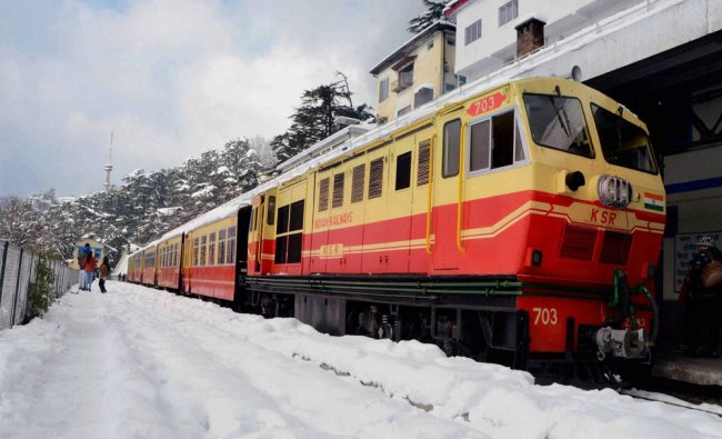 A toy train on a snow covered railway track after heavy snowfall in Shimla...