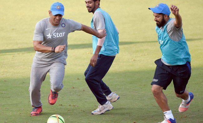 Indian cricketer MS Dhoni alongwith team players during a practice session in Mumbai on...
