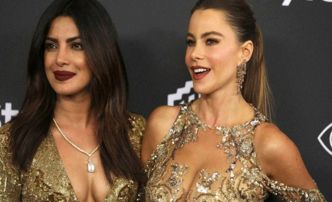 Priyanka Chopra, left, and Sofia Vergara arrive at the InStyle and Warner Bros. Golden Globes...