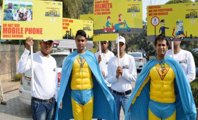 Maruti Suzuki India Ltd employees and traffic police men at a road traffic awareness rally...