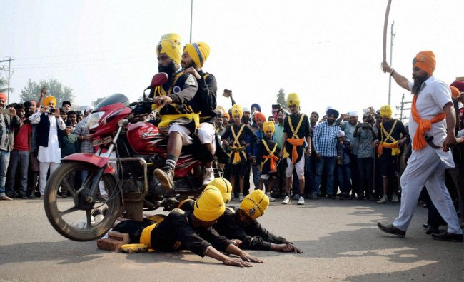 People from the Sikh community taking out a religious procession and displaying Sikh martial...