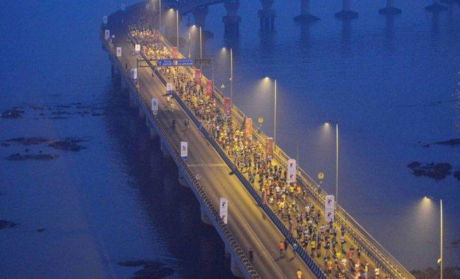 People take part in marathon on the Bandra-Worli Sea Link, in Mumbai...