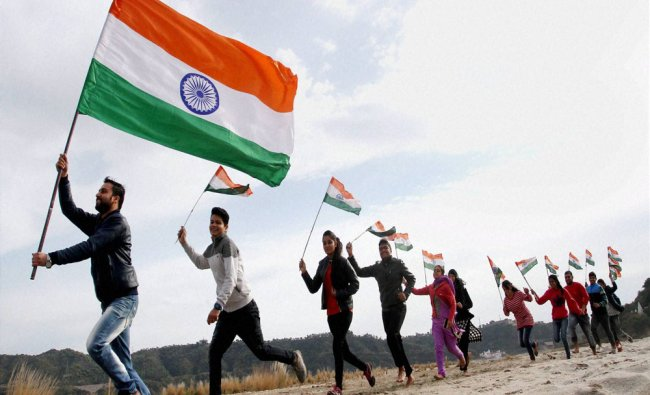 ABVP activists run with the Tricolours at an event ahead of Republic Day on the outskirts ...