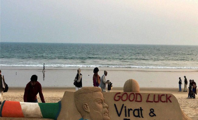 A sand sculpture of Virat Kohli with a message wishing him and the Indian team luck...