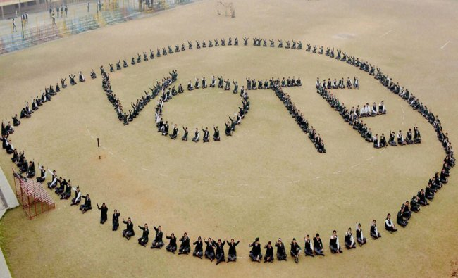 Students form a human chain to display VOTE at an awareness campaign Jalandhar...