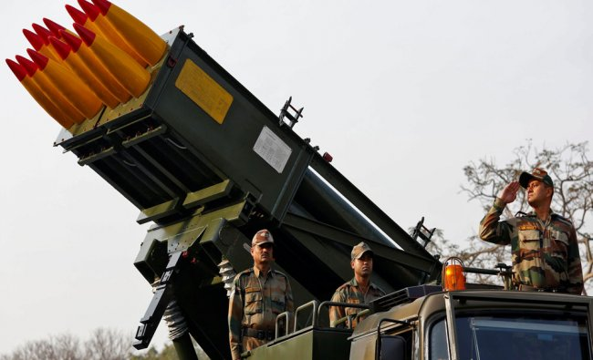 Army officers stand on Indian Army\'s Pinaka multi-barrel rocket launcher system...