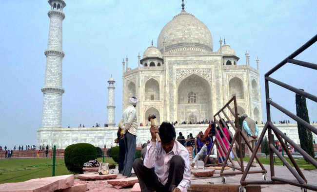 Archaeological Survey of India workers conducting restoration work at Taj Mahal in Agra...