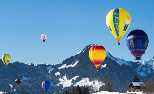 Hot air balloons fly during the 39th International Hot Air Balloon Week in Switzerland...