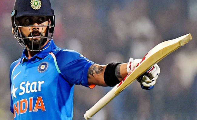 India Captain Virat Kohli celebrate after his 50 runs during 3rd ODI against England at Eden...