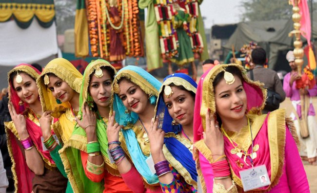 Punjab tableaux artists pose a photo during a press preview in New Delhi on Sunday...