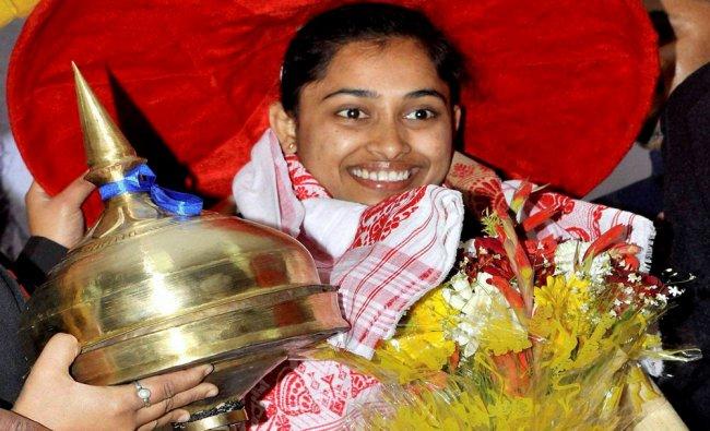 Olympic finalist Gymnast Dipa Karmakar being felicitated with Assames japi,Khoria and gomacha...