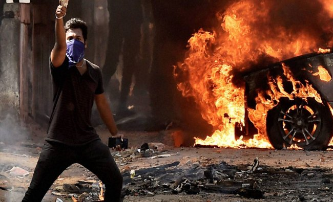 A Pro-Jallikattu protester throws bottle at the police during a violent clash near Marina Beach...
