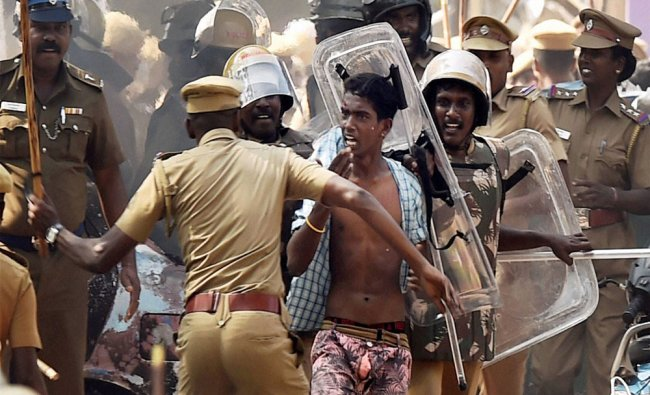 Riot Control Police take away pro-Jallikattu protesters after a clash at the Marina Beach...