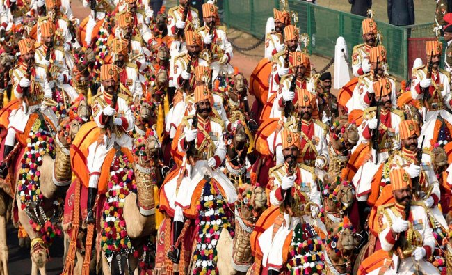 Camel mounted Indian Border Security Force soldiers march during the full dress rehearsal for...
