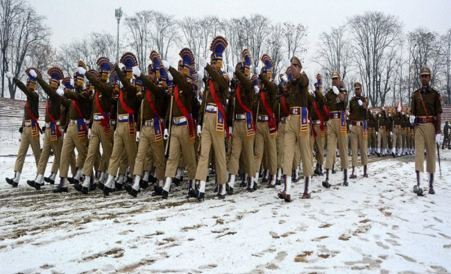 Jammu and Kashmir Police contingent marching past at snow-covered field during full dress...