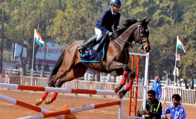 An expert horse rider from Madhya Pradesh Equestrian Academy showing his skills during full dress...