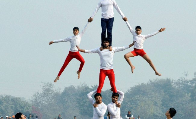 Students perform during full dress rehearsal for Republic Day function in Gurugram on Tuesday...