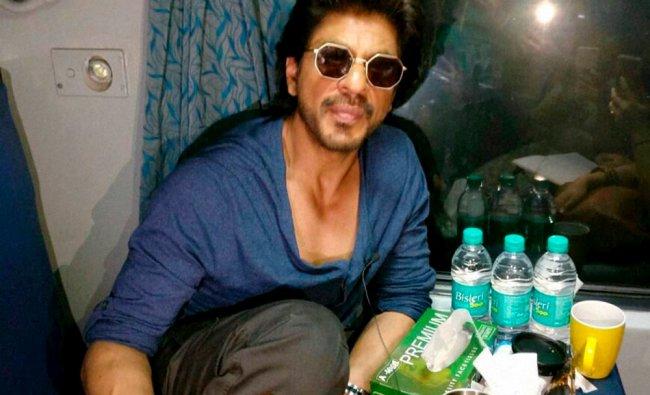 Actor Shah Rukh Khan travels from Mumbai to Delhi in August Kranti Rajdhani Express while...