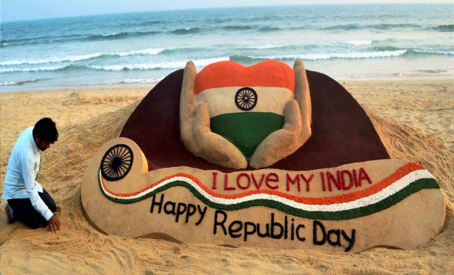 Sand artist Sudarshan Pattnaik makes a sand sclupture on the eve of Republic Day at Puri beach...