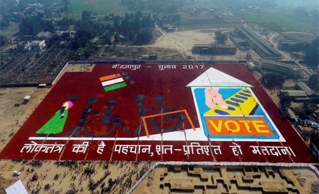 Three thousand five hundred school children make a huge Rangoli in an attempt to register...