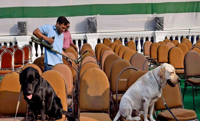 Security personnel with sniffer dogs at a security inspection ahead of Republic Day parade...