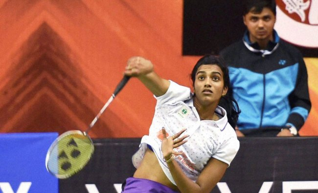 P V Sindhu in action in Syed Modi International Badminton Championship match at Babu Babarasi Das...