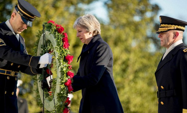 British Prime Minister Theresa May lays a wreath at the Tomb of the Unknowns at Arlington...