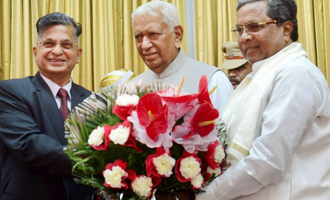 Karnataka Chief Minister Siddaramaiah and Karnataka Governor Vajubhai Rudabhai Vala presents...