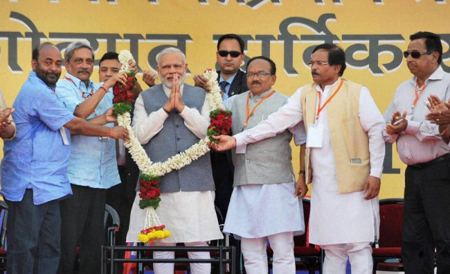Prime Minister Narendra Modi being garlanded during his election rally...
