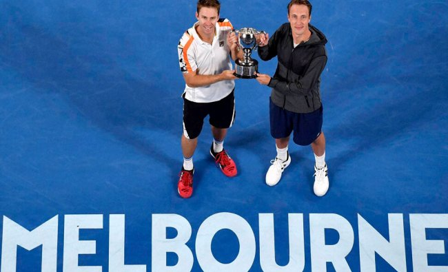 Finland\'s Henri Kontinen, right, and Australia\'s John Peers hold their trophy...